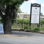 Two signs outside a winery - Cellar Door Open and a police sign next to it, Cell Door Open.